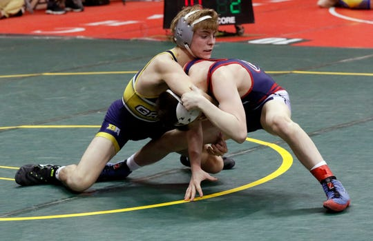Lancaster's Logan Agin competes in a first-round match in the 103-pound weight class during the Division I state wrestling tournament. He won his first two matches to advance to the semifinals.