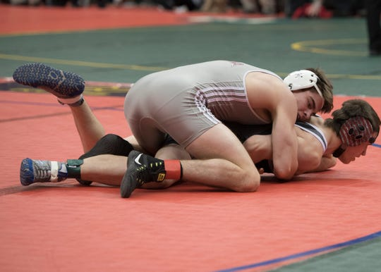 Genoa's Dustin Morgillo wrestles Sandy Valley's Jacob Newell at 145 during the first day of the OHSAA state wrestling tournament at the Schottenstein Center. Morgillo won his match.
