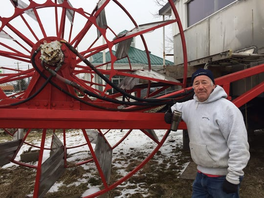 Buckeye Lake Historical Society volunteer Bill Cullinson describes how the paddlewheel of the Queen of the Lake III will work once restoration work is finished.