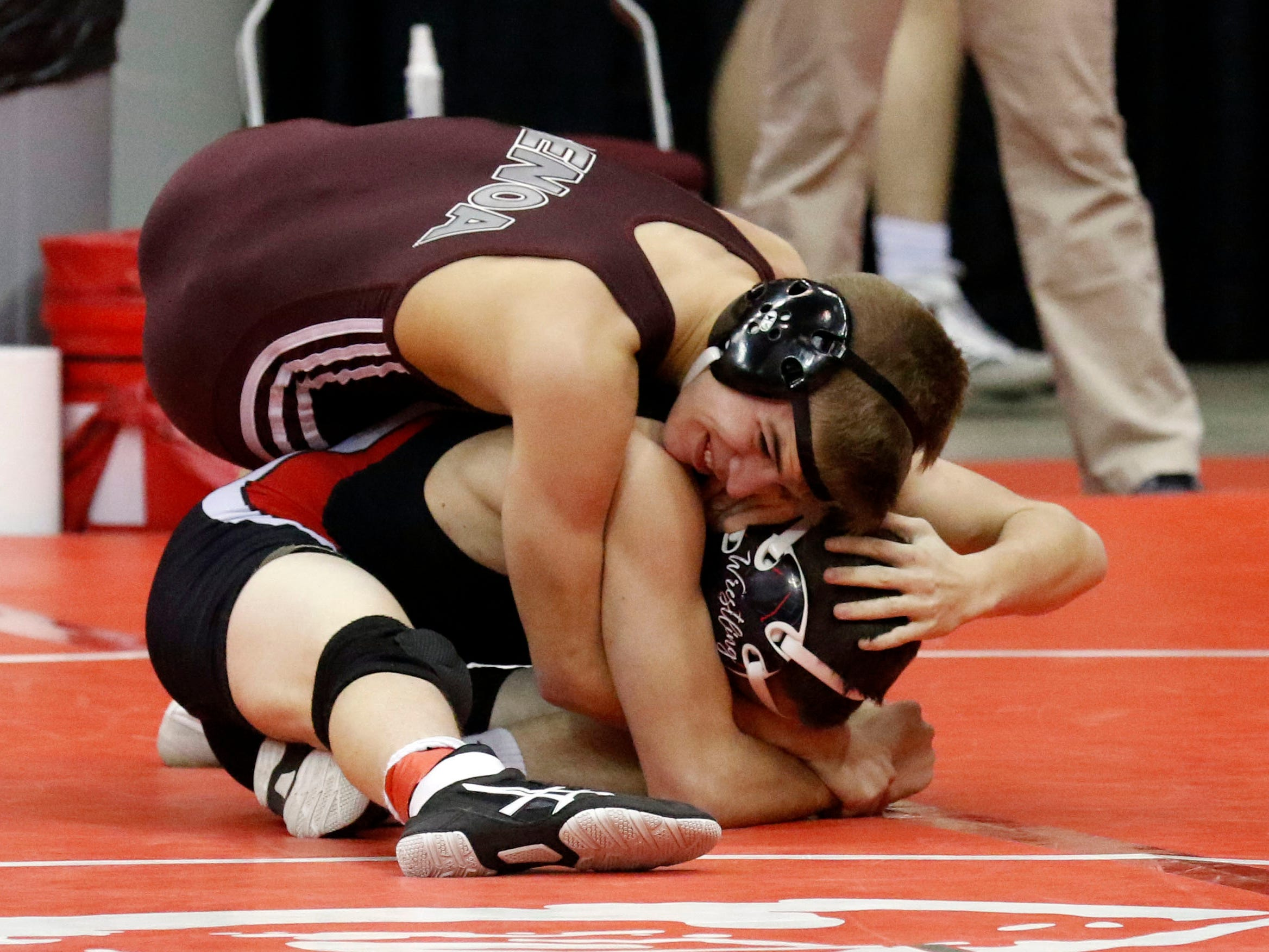 Genoa's Oscar Sanchez wrestles Friday, March 8, 2019, during the State Wrestling Tournament at the Jerome Schottenstein Center at Ohio State University in Columbus.