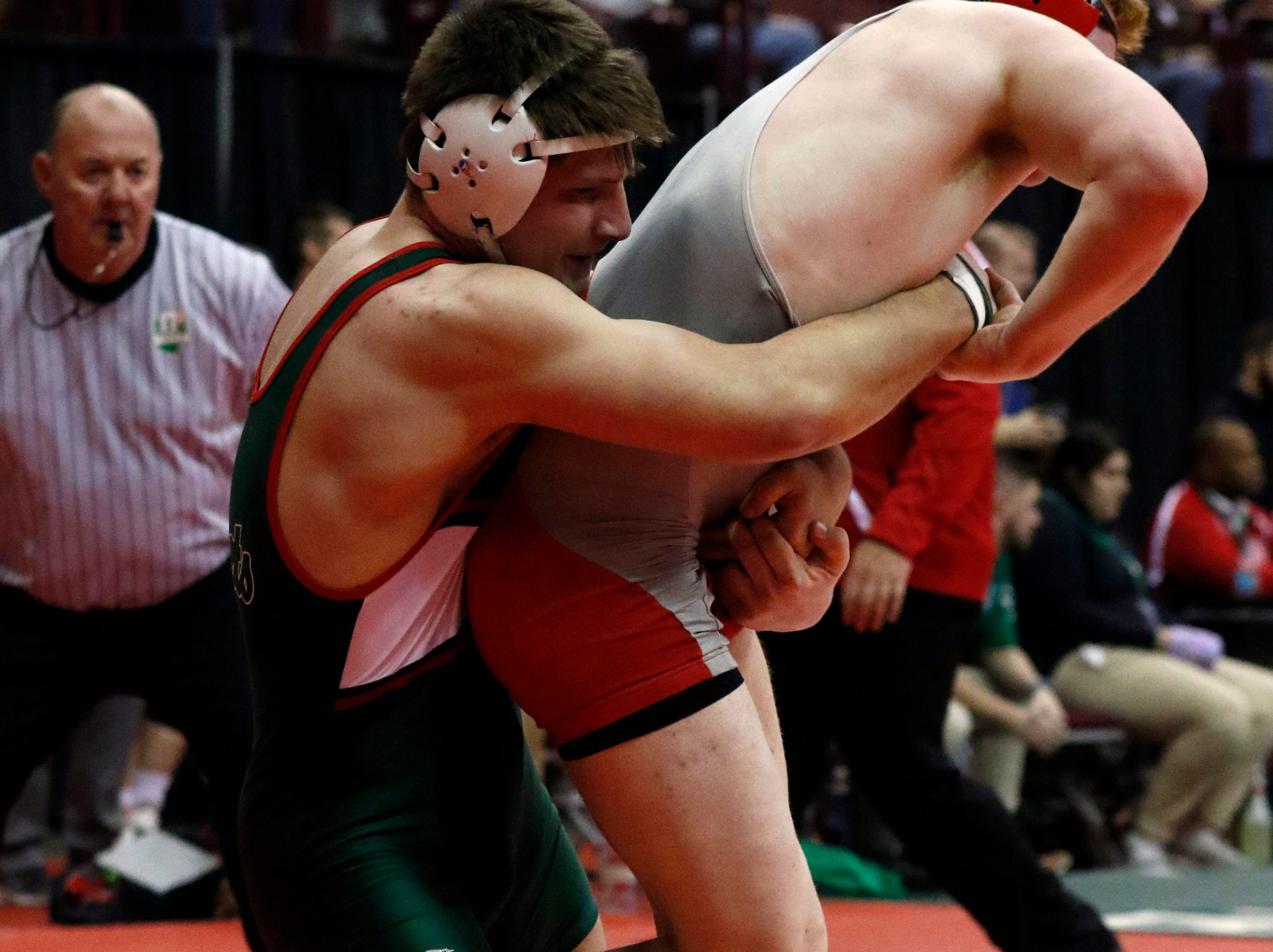 Oak Harbor's Jake Sage wrestles during the State Wrestling Tournament Thursday, March 7, 2019, at the Jerome Schottenstein Center at Ohio State University in Columbus.