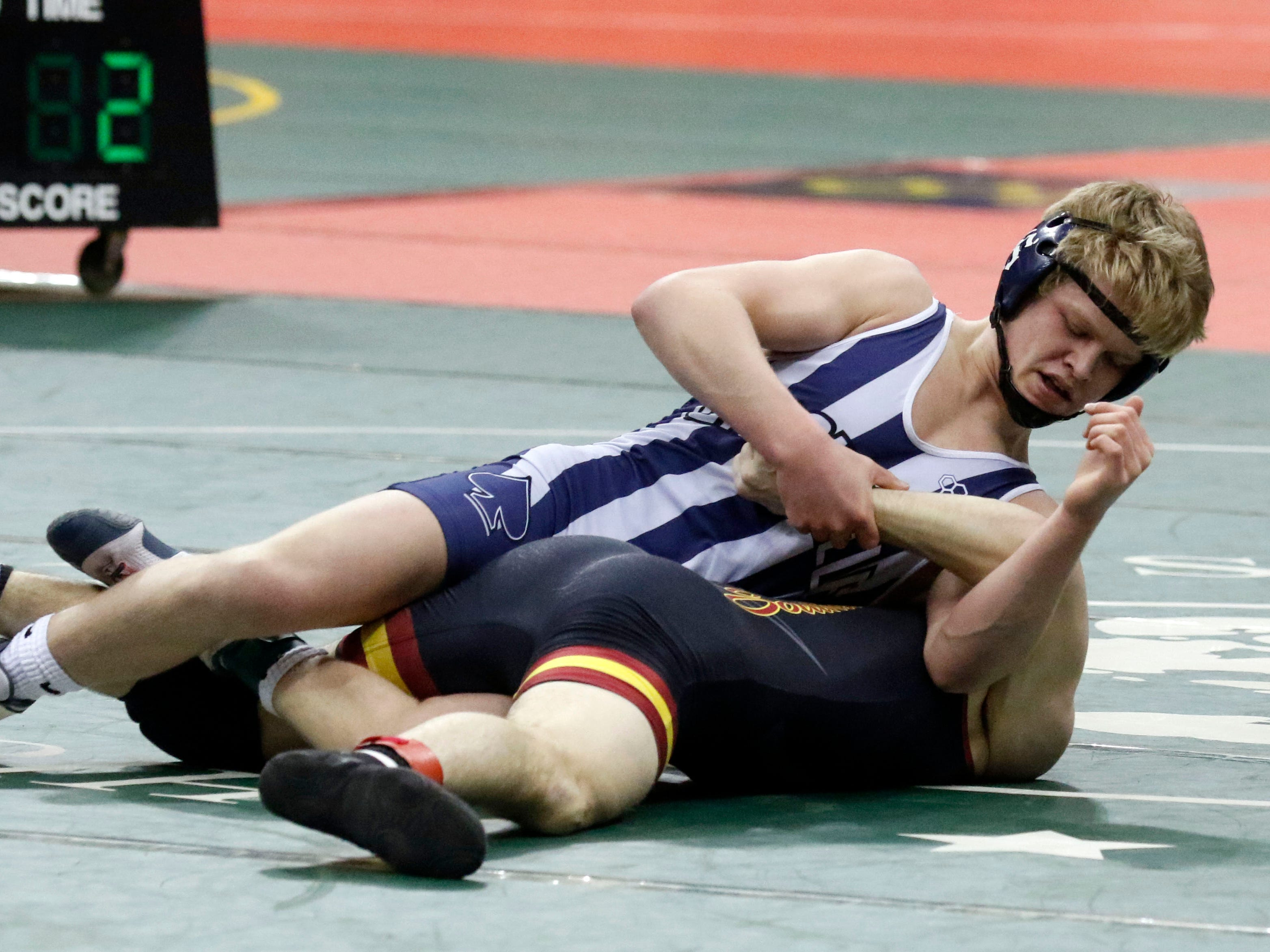 Granville's Douglas Terry wrestles Friday during the State Wrestling Tournament at the Jerome Schottenstein Center at Ohio State. University in Columbus.