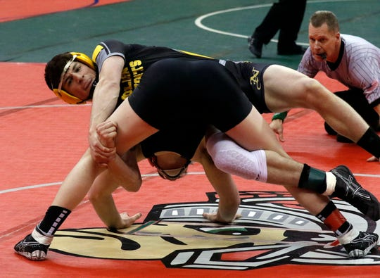 Northmor's Tony Martinez controls Mohawk's Morgan Price during the first round of the state wrestling tournament.