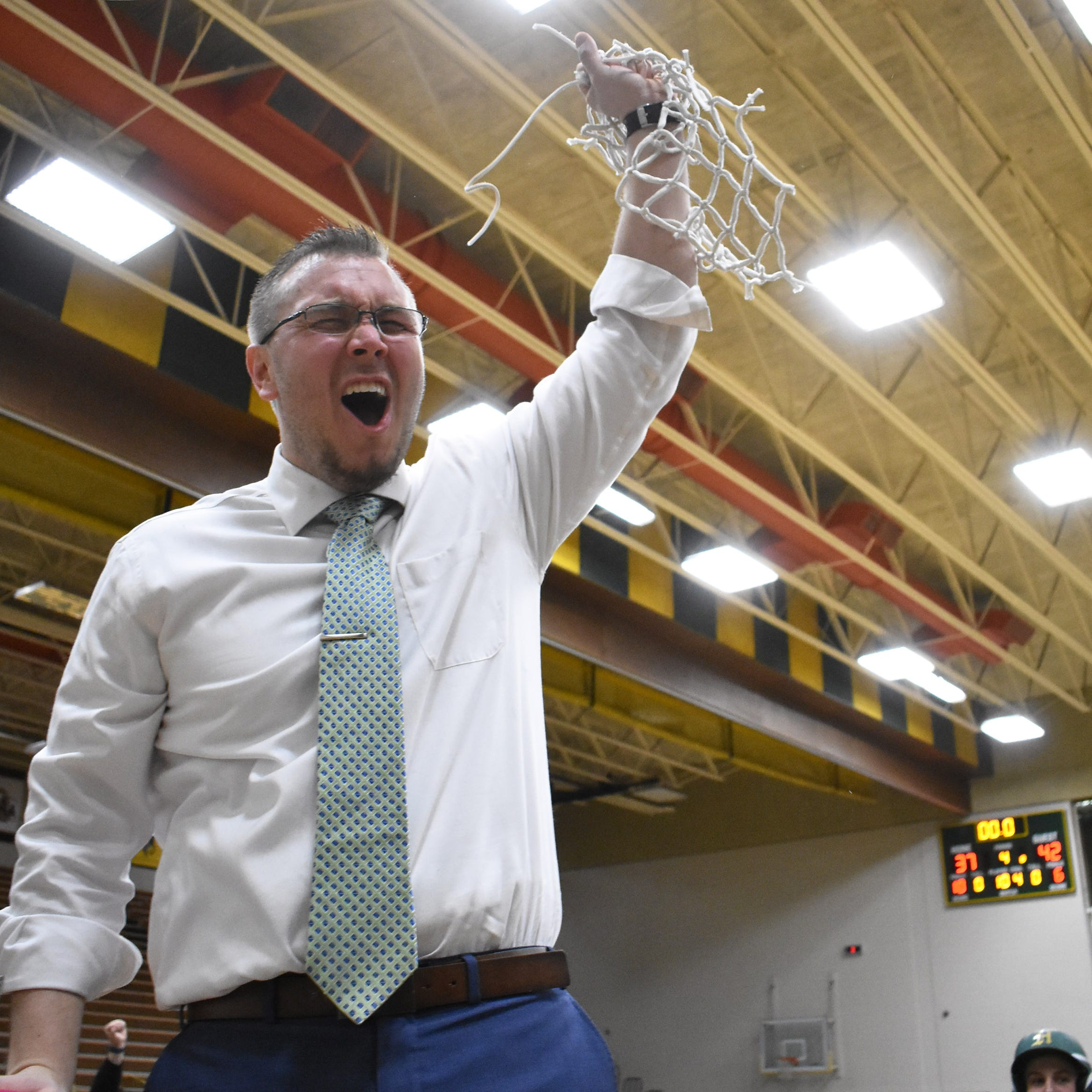 Inspired by 2014 team, Howell wins regional basketball championship