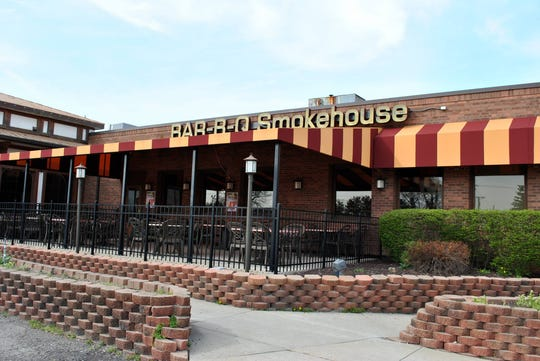 The owners of  Ginopolis' Bar-B-Q Smokehouse in Farmington Hills, pictured, are gearing up to open a new eatery in downtown Brighton. They plan to close the Farmington Hills location. A senior and assisted-living facility is proposed for the site.