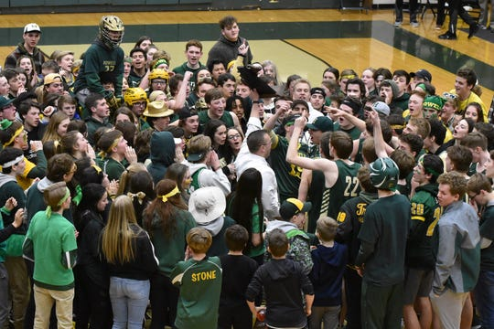 Howell's basketball team celebrates on the court with its fans following a 42-37 victory over Oxford in the regional championship game on Thursday, March 7, 2019.