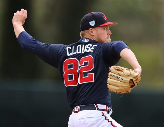 Atlanta Braves pitcher Corbin Clouse delivers a pitch during live batting practice in Kissimmee, Fla., Wednesday, Feb. 20, 2019. (Curtis Compton/Atlanta Journal-Constitution via AP)