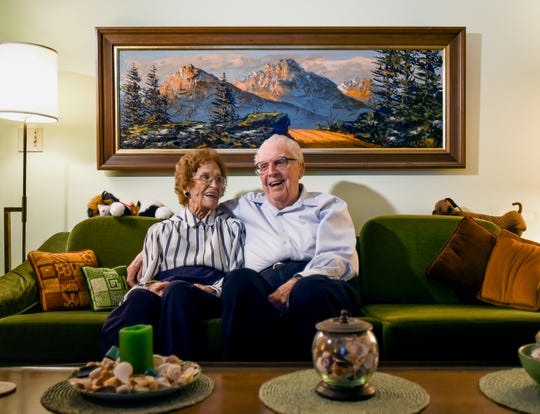 "Married for over seven decades, Helen, 94, and Howard Tanner, 95, share a laugh while having their portrait taken, Wednesday, Jan. 23, 2019, at their home in Haslett.  Howard is known as ""The Father of the Great Lakes salmon fishery.""  In 1966, commercial overfishing and invasive sea lampreys and alewives had decimated the trout population. As the then fisheries chief for the Department of Conservation, Tanner introduced Coho salmon to the Great Lakes.  The following year salmon fishing season was born."