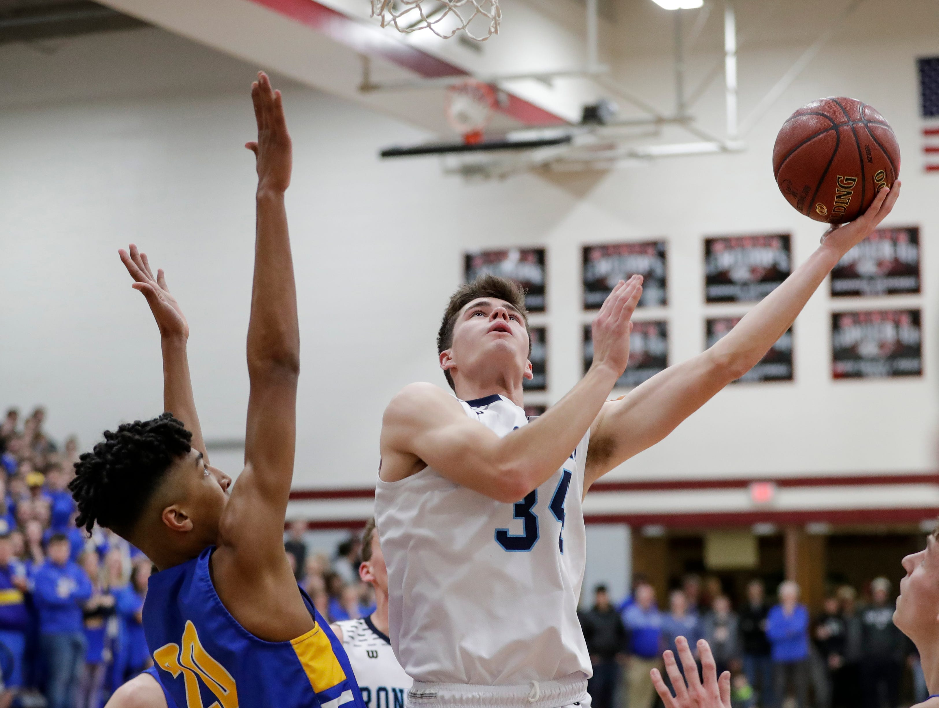 Roncalli's Ian Behringer shoots a layup against Howards Grove in a WIAA Division 4 sectional semifinal at New Holstein High School Thursday, March 7, 2019, in New Holstein, Wis. Joshua Clark/USA TODAY NETWORK-Wisconsin