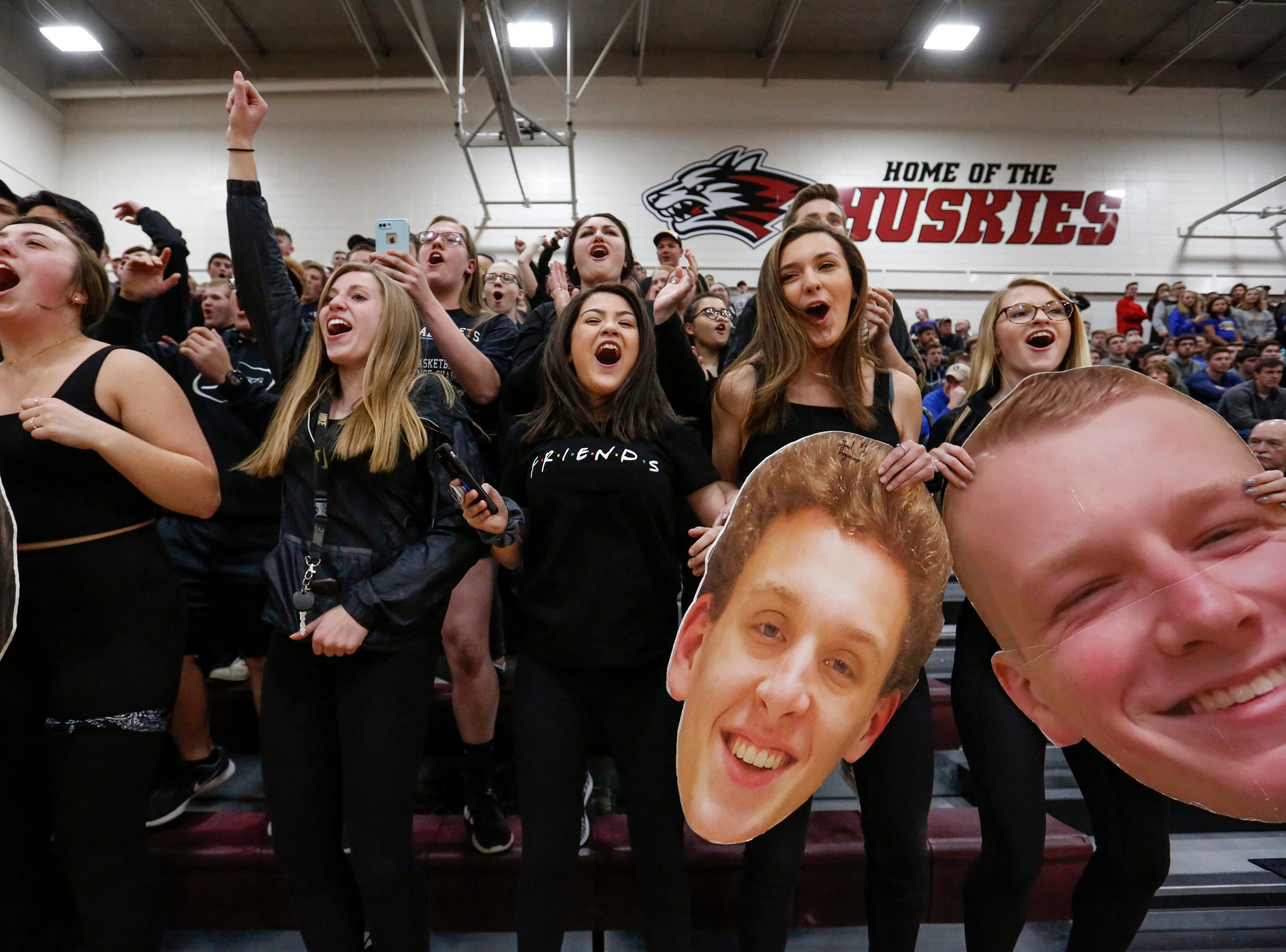 Roncalli's student section reacts as the final seconds tick off the clock and the Jets defeat Howards Grove 63-50 in a WIAA Division 4 sectional semifinal at New Holstein High School Thursday, March 7, 2019, in New Holstein, Wis. Joshua Clark/USA TODAY NETWORK-Wisconsin
