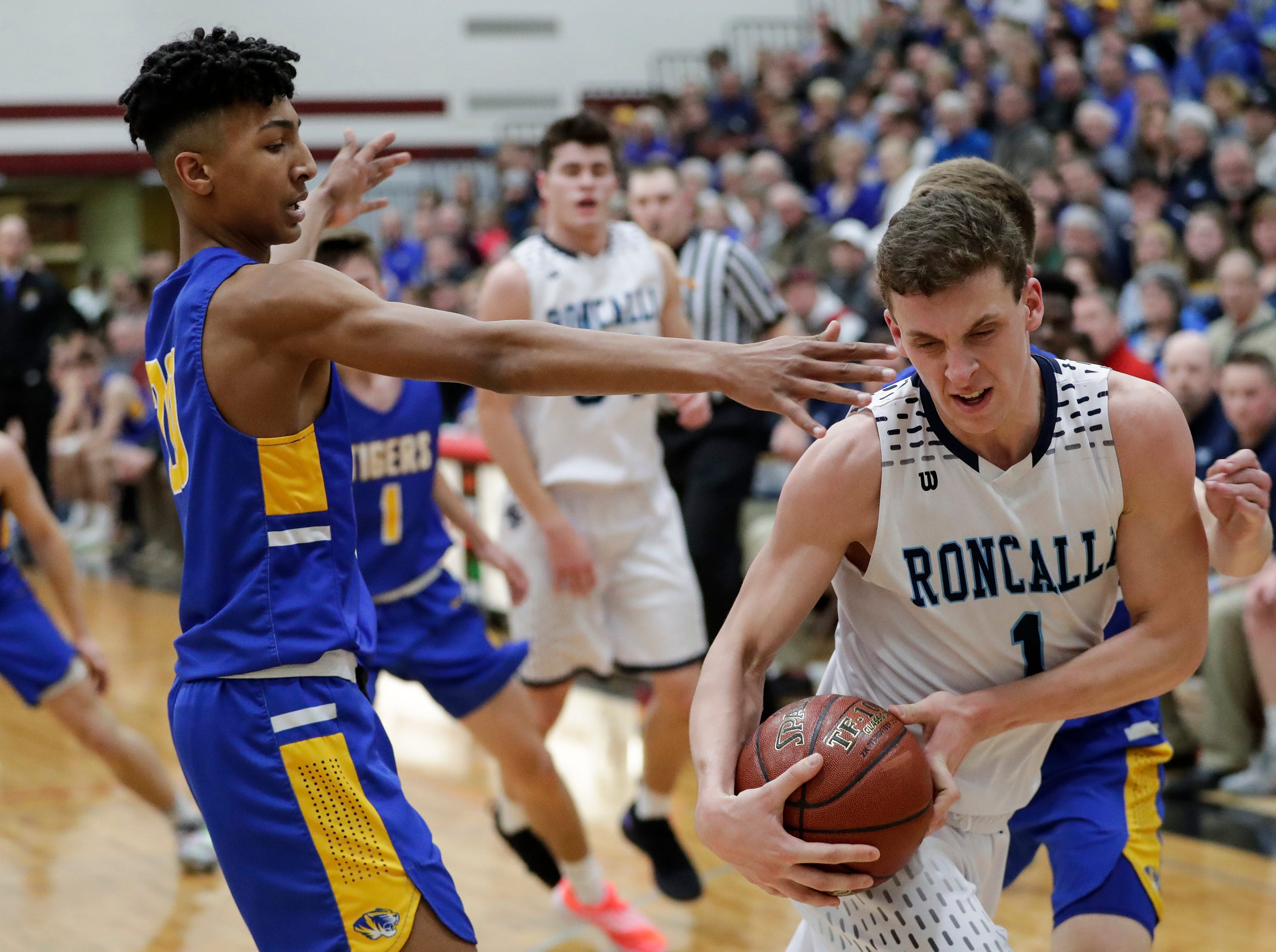 Roncalli's Daniel Burgarino (1) fights to keep control of the ball against Howards Grove during a WIAA Division 4 sectional semifinal at New Holstein High School Thursday, March 7, 2019, in New Holstein, Wis. Joshua Clark/USA TODAY NETWORK-Wisconsin