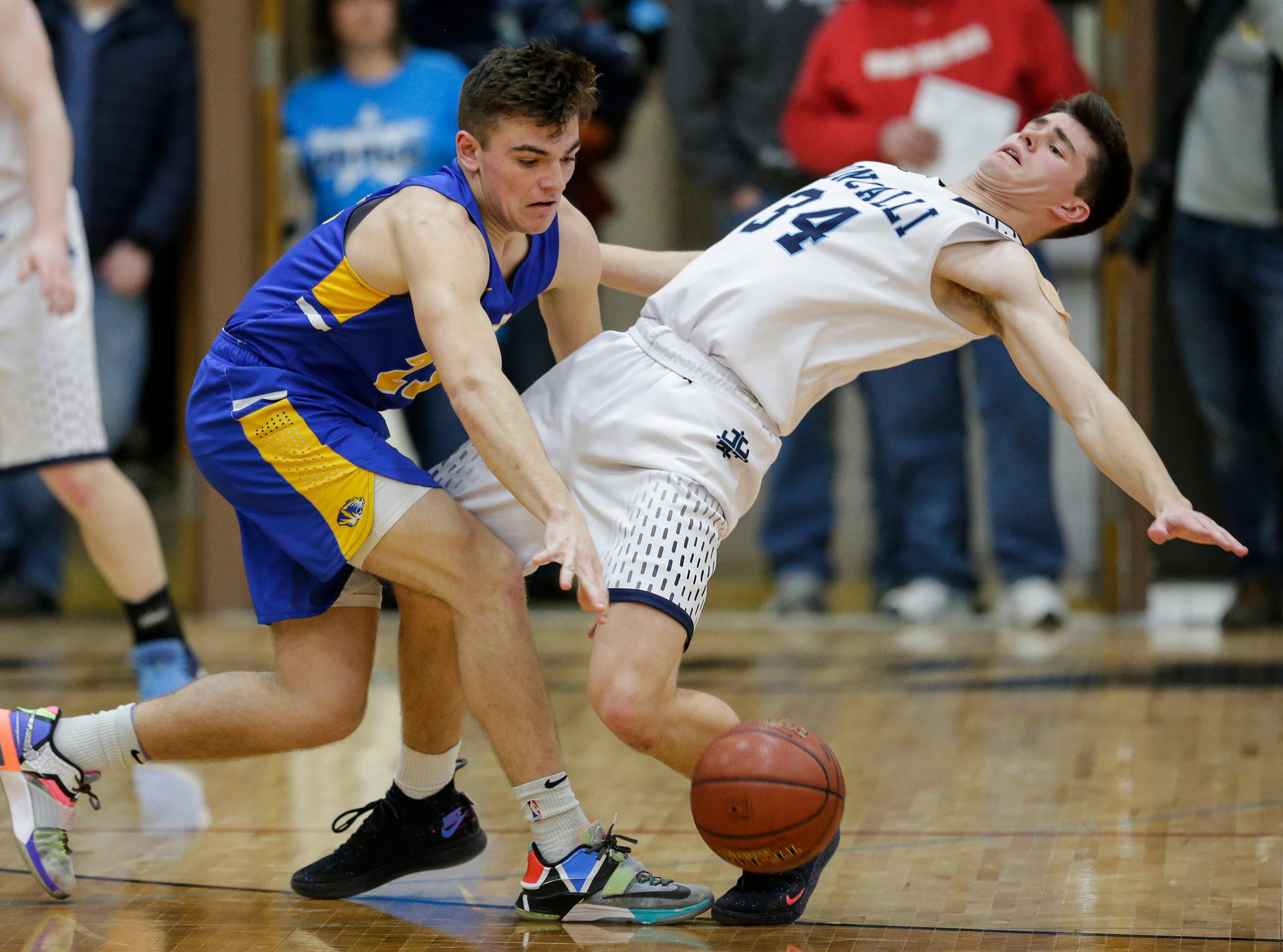 Howards Grove's Dalton Free (23) fouls Roncalli's Ian Behringer (34) in a WIAA Division 4 sectional semifinal at New Holstein High School Thursday, March 7, 2019, in New Holstein, Wis. Joshua Clark/USA TODAY NETWORK-Wisconsin