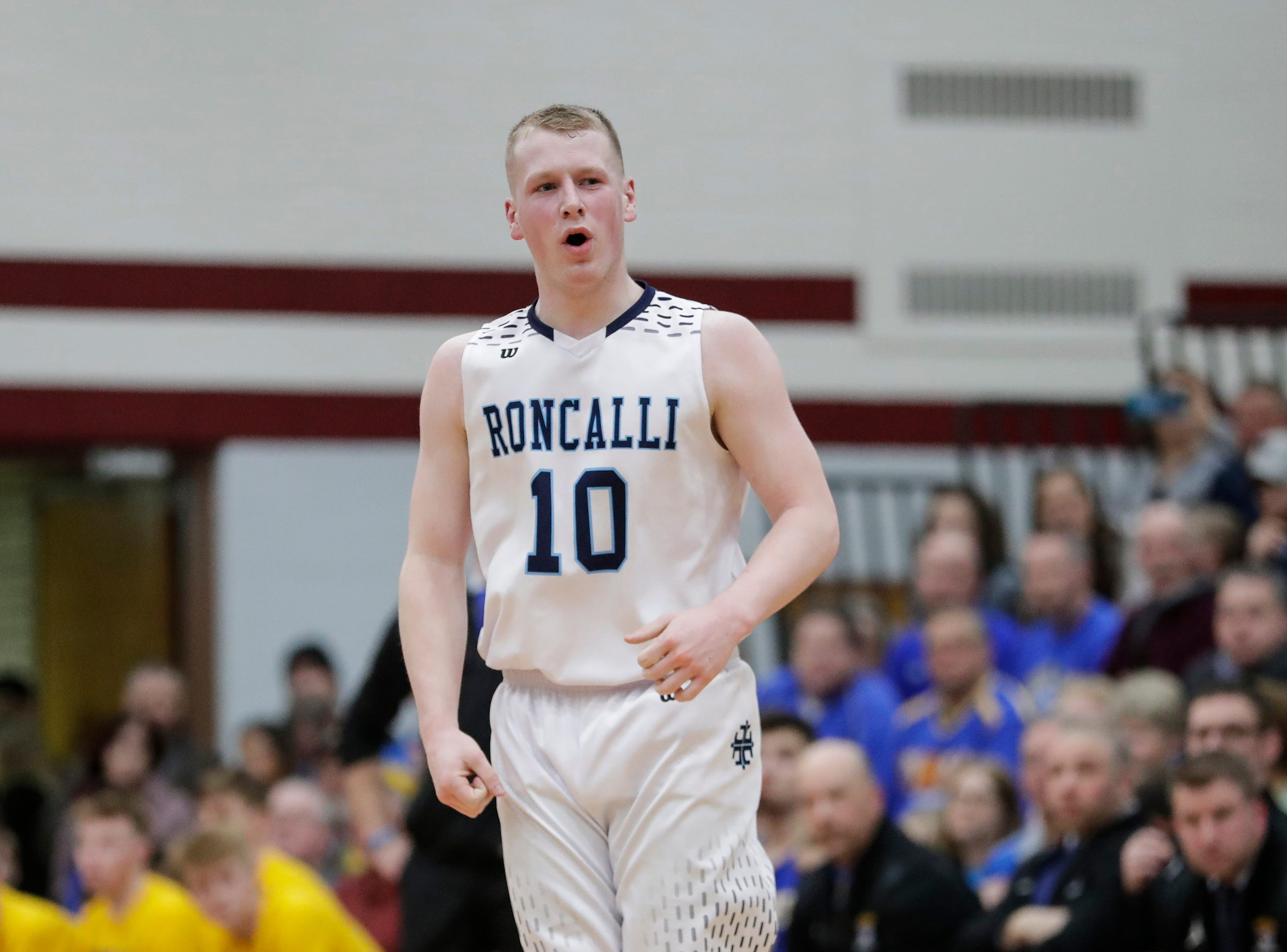 Roncalli's Matt Le Vene reacts after sinking a three against Howards Grove in a WIAA Division 4 sectional semifinal at New Holstein High School Thursday, March 7, 2019, in New Holstein, Wis. Joshua Clark/USA TODAY NETWORK-Wisconsin