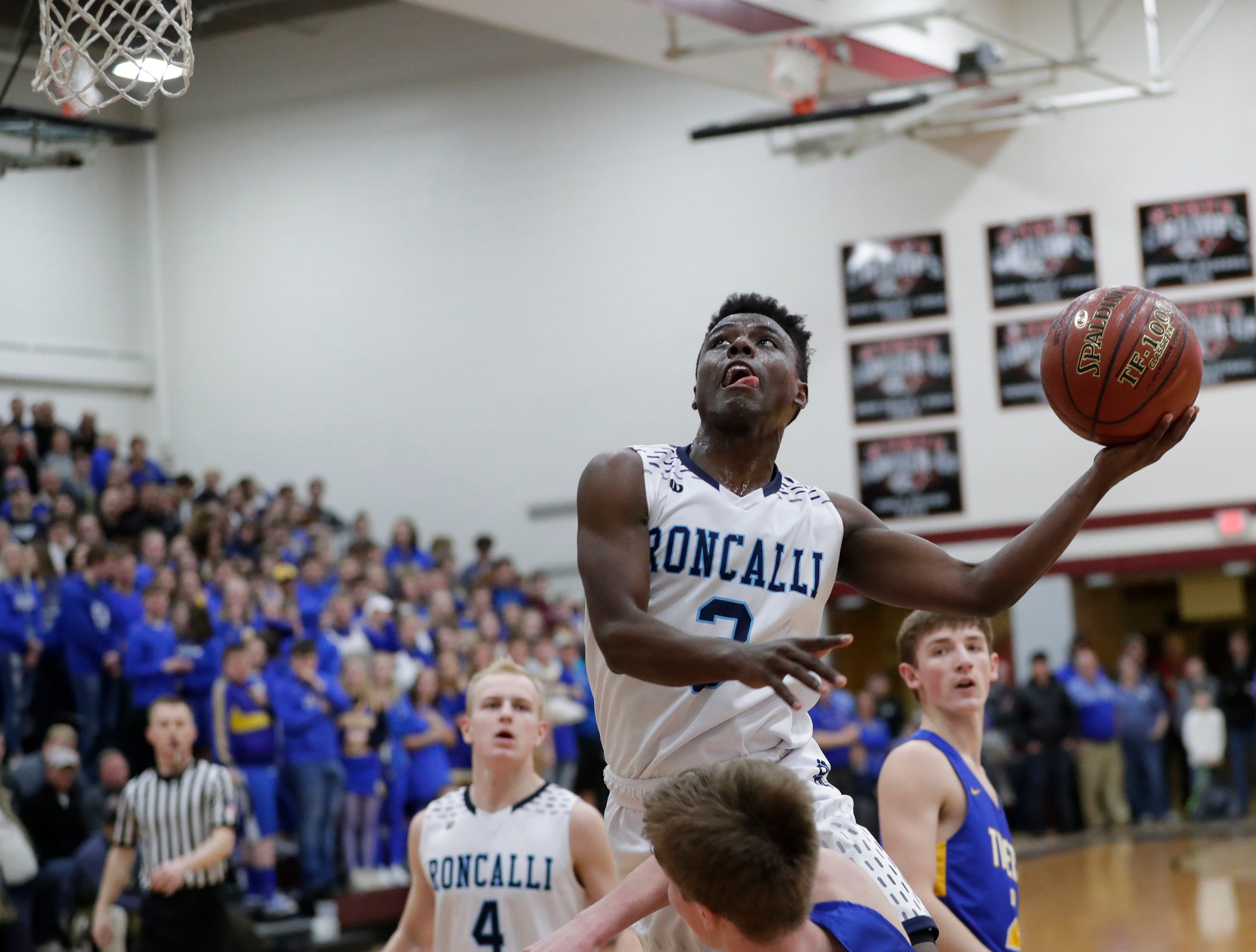 Roncalli's Chombi Lambert (3) takes it to the basket against Howards Grove in a WIAA Division 4 sectional semifinal at New Holstein High School Thursday, March 7, 2019, in New Holstein, Wis. Joshua Clark/USA TODAY NETWORK-Wisconsin
