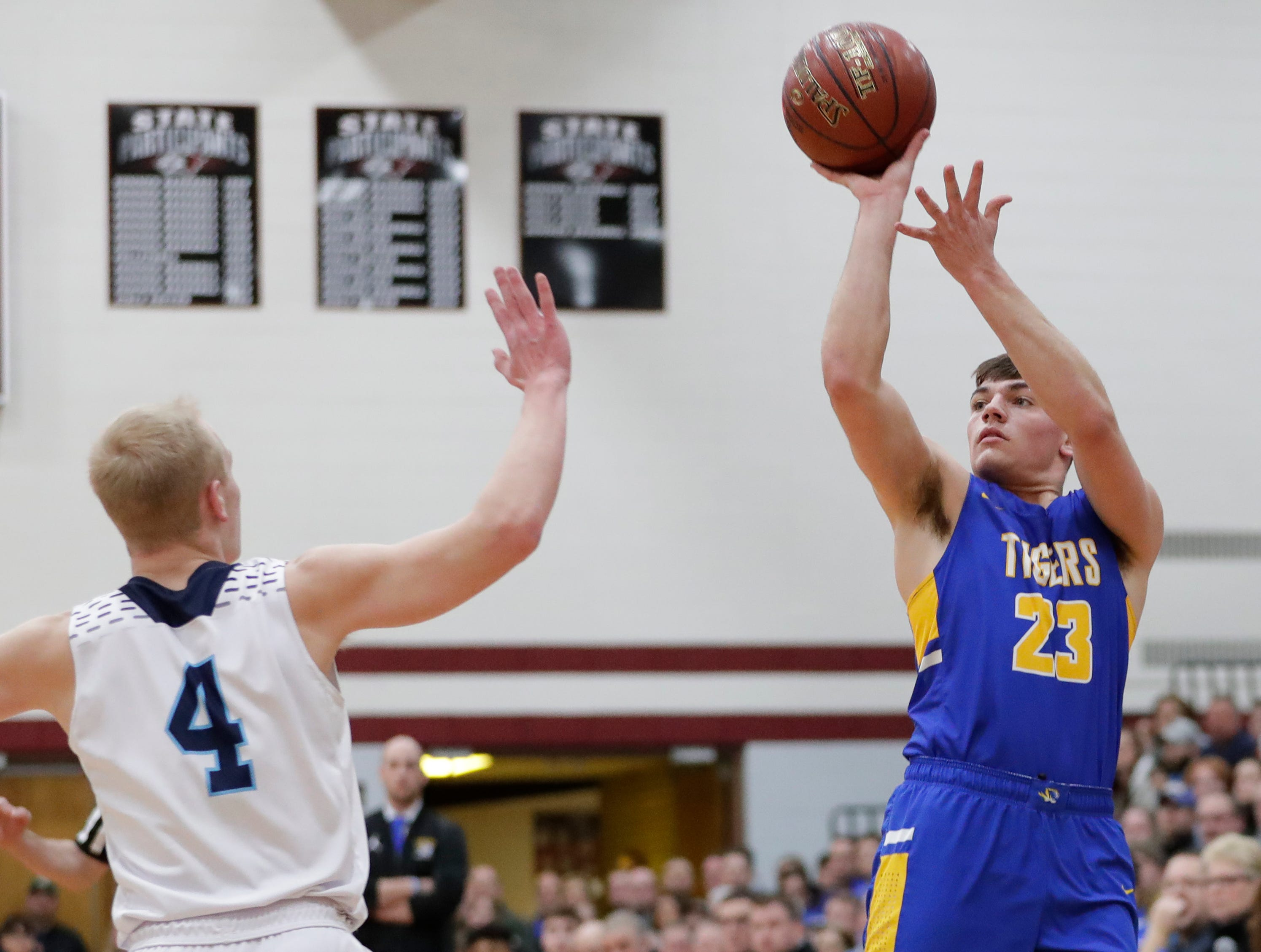 Howards Grove's Dalton Free (23) puts up a shot against Roncalli during a WIAA Division 4 sectional semifinal at New Holstein High School Thursday, March 7, 2019, in New Holstein, Wis. Joshua Clark/USA TODAY NETWORK-Wisconsin