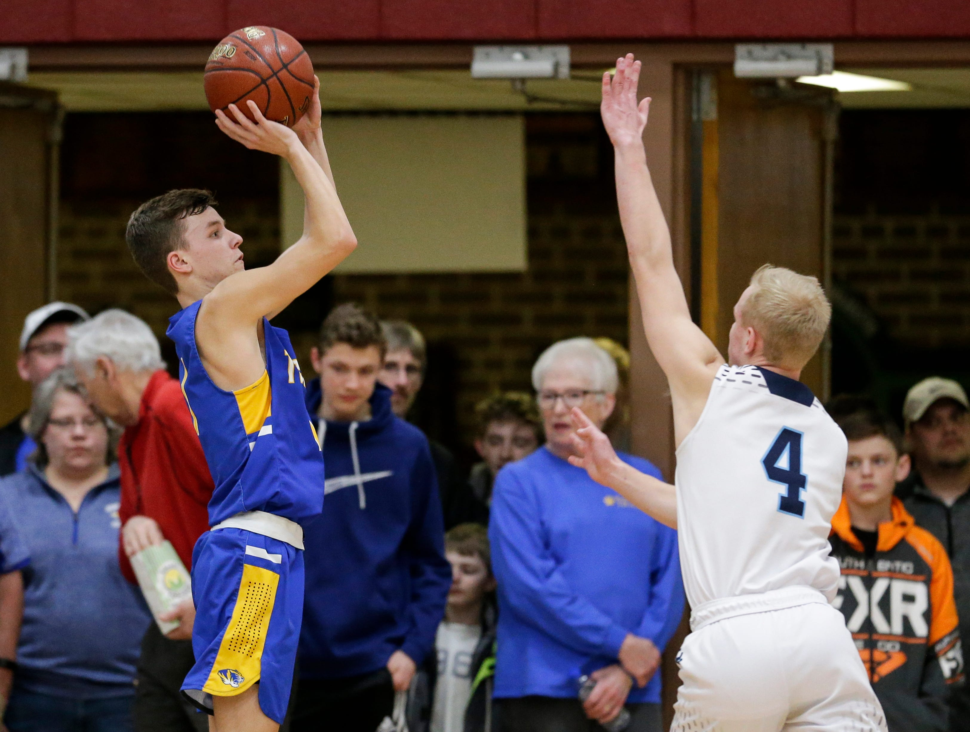 Howards Grove's Blake Pedrin (1) sinks a three against Roncalli in a WIAA Division 4 sectional semifinal at New Holstein High School Thursday, March 7, 2019, in New Holstein, Wis. Joshua Clark/USA TODAY NETWORK-Wisconsin