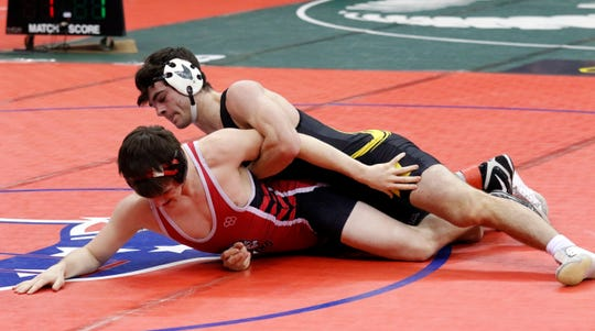 Northmor's Conor Becker battles Rittman's Sevi Garza in a Division III 170-pound quarterfinal match at the state wrestling tournament. Becker won with a last second pin.
