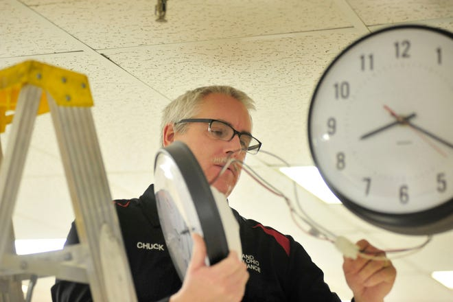 Chuck Minich, superintendent of maintenance for Richland County commissioners, takes a look inside one of the courthouse clocks that will be advanced one hour when daylight saving time begins.