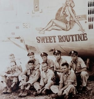 """WWII veteran Jack Graham served as a navigator on a consolidated B-24 liberator, which he and his crew had nicknamed """"Sweet Routine."""" Pictured here, Graham is third from the left in the second row."""