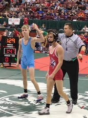 River Valley freshman Drake Cerny gets his hand raised after coming up with a pin in his opener at the state wrestling tournament Thursday in Division II's 106-pound class.