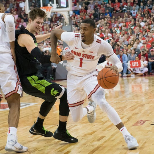 Ohio State freshman Luther Muhammad drives to the basket against Michigan State earlier this season.