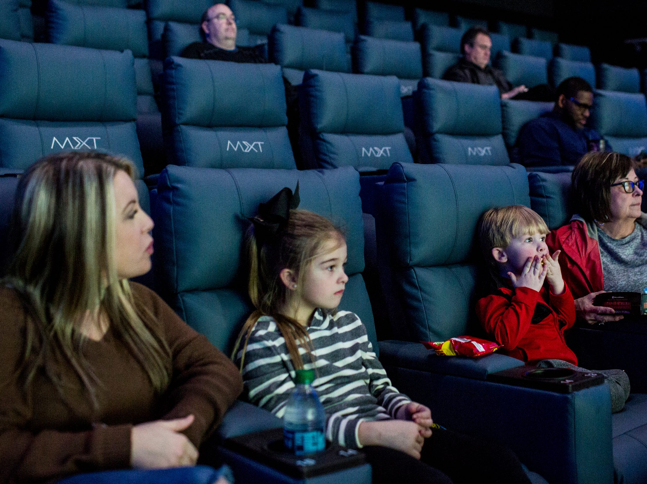 March 08, 2019 - From left, Haley Moak and her children, Randi Rae, 7, Parker, 3, and mother, Shelly Harrell, wait for the start of their movie at Malco Powerhouse Cinema Grill & Bar.