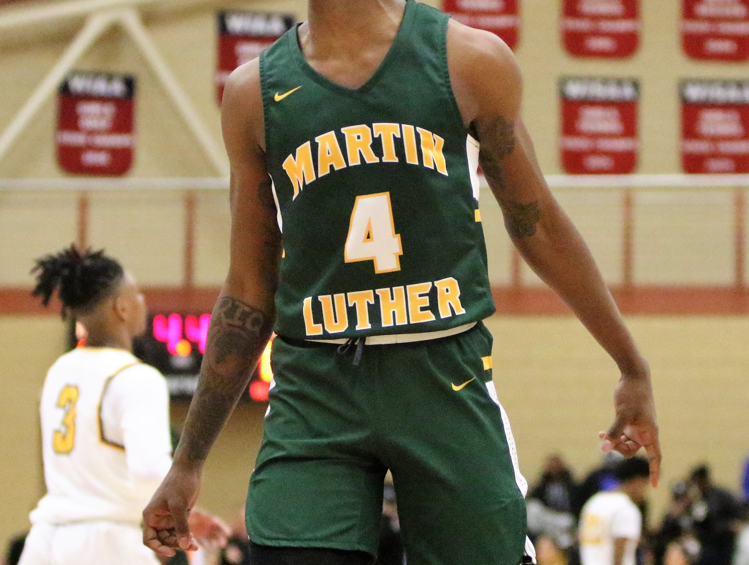 Martin Luther forward Xzavier Jones celebrates his team's win over Racine St. Catherine's in a WIAA sectional semifinal on March 7, 2019.