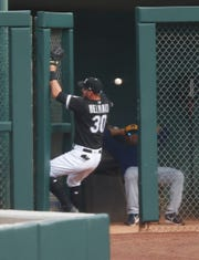 White Sox leftfielder Nicky Delmonico crashes into the bullpen door as he attempts to catch a ball hit by Brewers catcher Manny Pina in the seventh inning  Thursday.