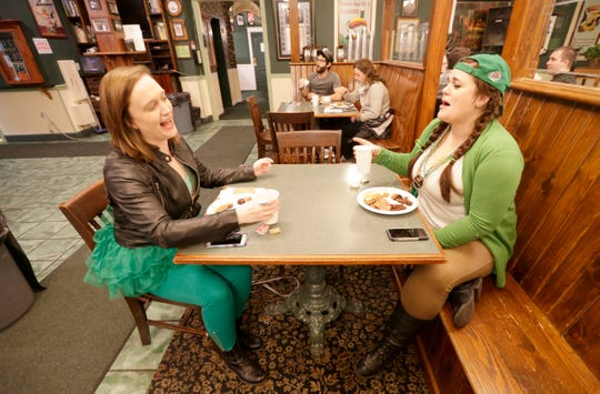 LeAnn Vance (left) and  Brittany Boeche, both of Milwaukee, have a laugh and an Irish breakfast at County Clare Irish Inn & Pub on St. Patrick's Day in 2017.