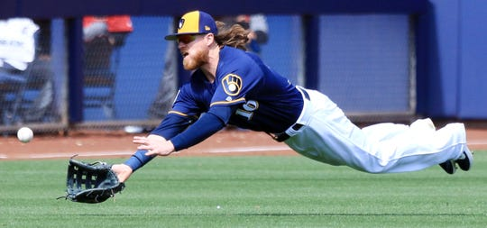 Ben Gamel attempts a diving catch.