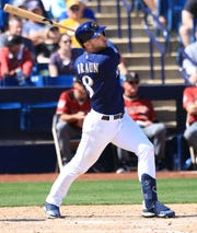 Ryan Braun hits a single during his first spring game of the season on Friday.
