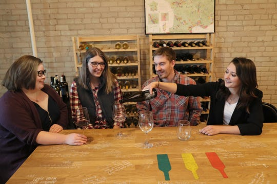 Amanda Hollinger (from left), Courtney Severson, Zach Rosen and Hillary Higbee taste test new wines in the Wine Cave. Milwaukee-based wine subscription service Bright Cellars is growing its team by 10 employees in the next six months.