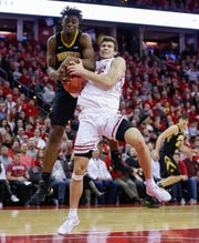 UW forward Ethan Happ battles Iowa's Tyler Cook for a rebound during the second half.