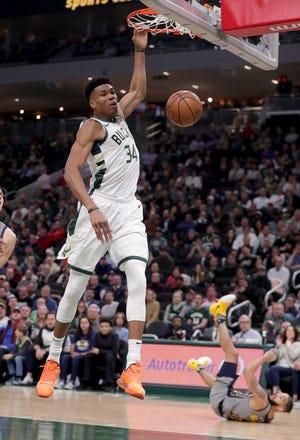 Bucks forward Giannis Antetokounmpo dunks against the Pacers on Thursday night.