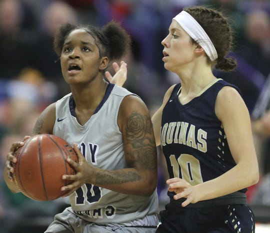 Milwaukee Academy of Science senior Shemera Williams (left) is re-evaluating her options for college in the wake of coach Carolyn Kieger's departure from Marquette to take over Penn State's program.