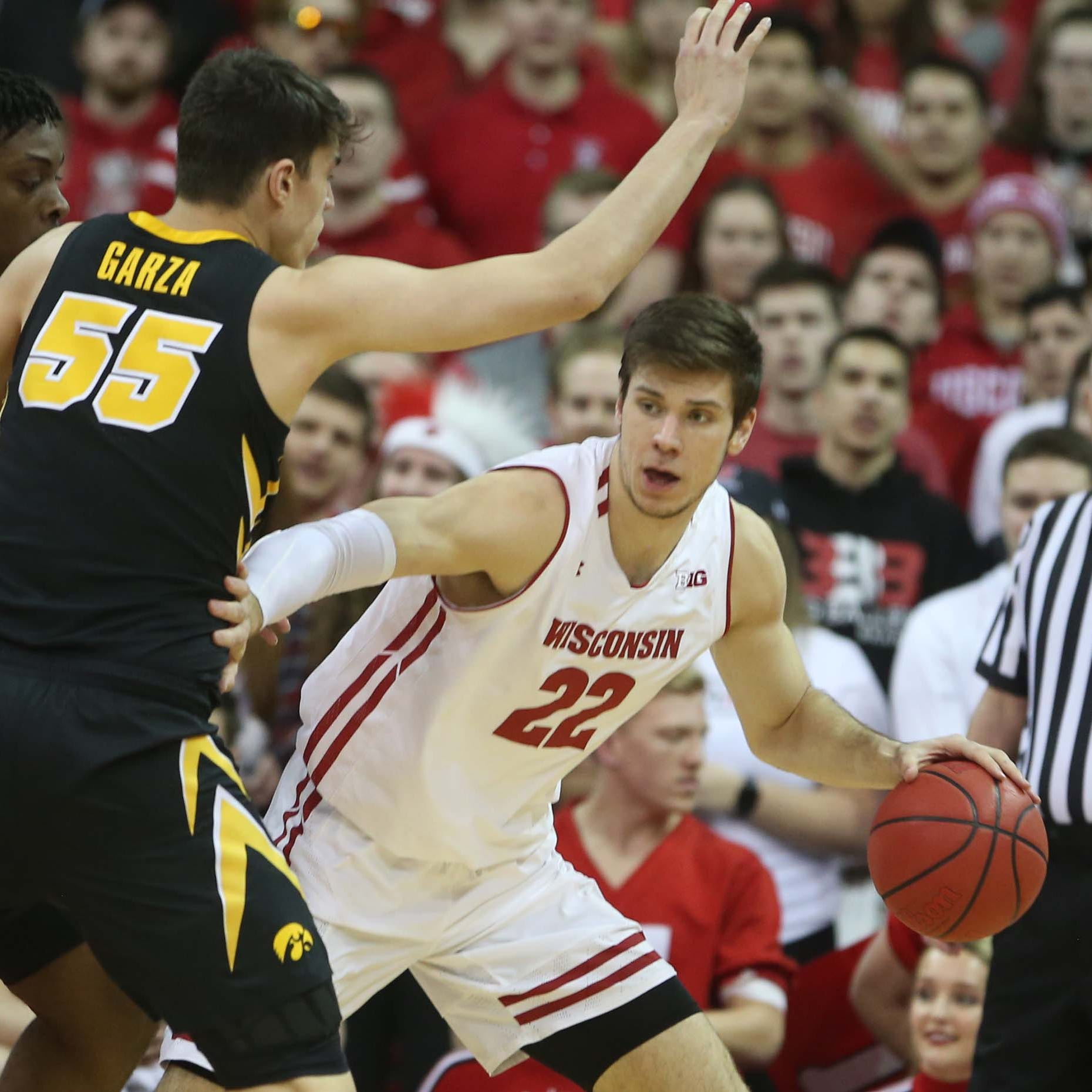UW 65, Iowa 45: Happ's strong second-half surge helps the Badgers sweep their rivals