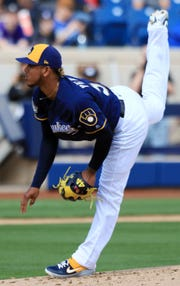 Milwaukee Brewers Freddy Peralta delivers a pitch during the second inning of their spring training game against the Arizona Diamondbacks, Friday, March 8, 2019, in Phoenix, Arizona.(Photo/Roy Dabner) ORG XMIT: RD161