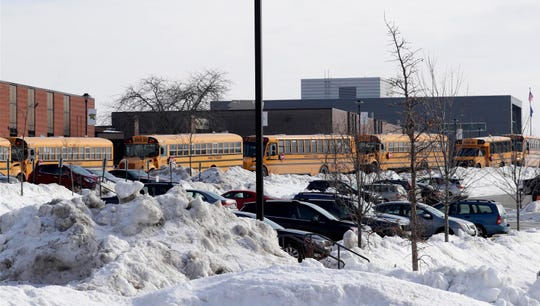 School buses are lined up outside Franklin High School last Friday as students prepare to leave.