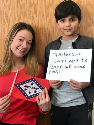 Virginia third-grader Khaled and his teacher, Molly Lyons, recently wrote to several state newspapers asking Arkansans to mail them items and information pertaining to The Natural State as part of a class project.