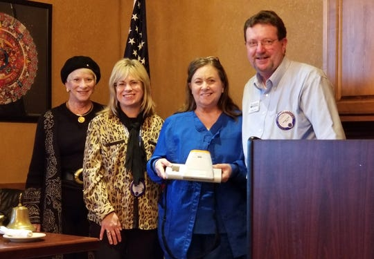 The Mountain Home Lions Club recently donated a vision screener to the Calico Rock School District. Pictured are: (from left) Lion Cynthia Dalrymple; Lion Jennifer Rowe; nurse Kaye Arnold of the Calico Rock School District; and Lion President George Truell. The Spot Vision Screener is a handheld, portable device designed to help quickly and easily detect vision issues on patients from child through adult.