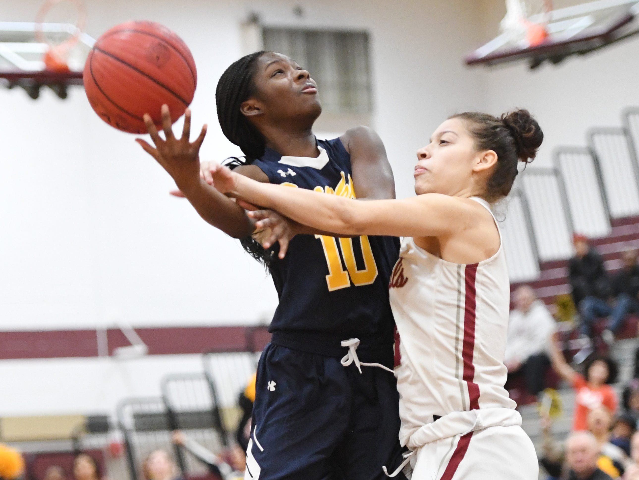 Franklin vs. Bloomfield in the girls basketball Group IV semifinal at Union High School on Thursday, March 7, 2019. F #10 Keona Schneck drives to the basket as B #5 Chiara Hillario defends.