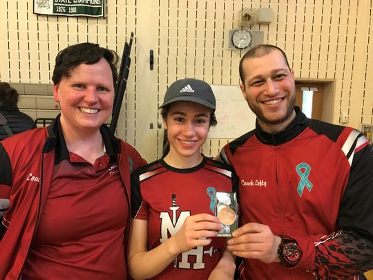 Morris Hills fencing coaches Lisa Campi-Sapery and Andrew Zlotnick congratulate senior Alexandra Szewc, who finished third in the NJSIAA epee.