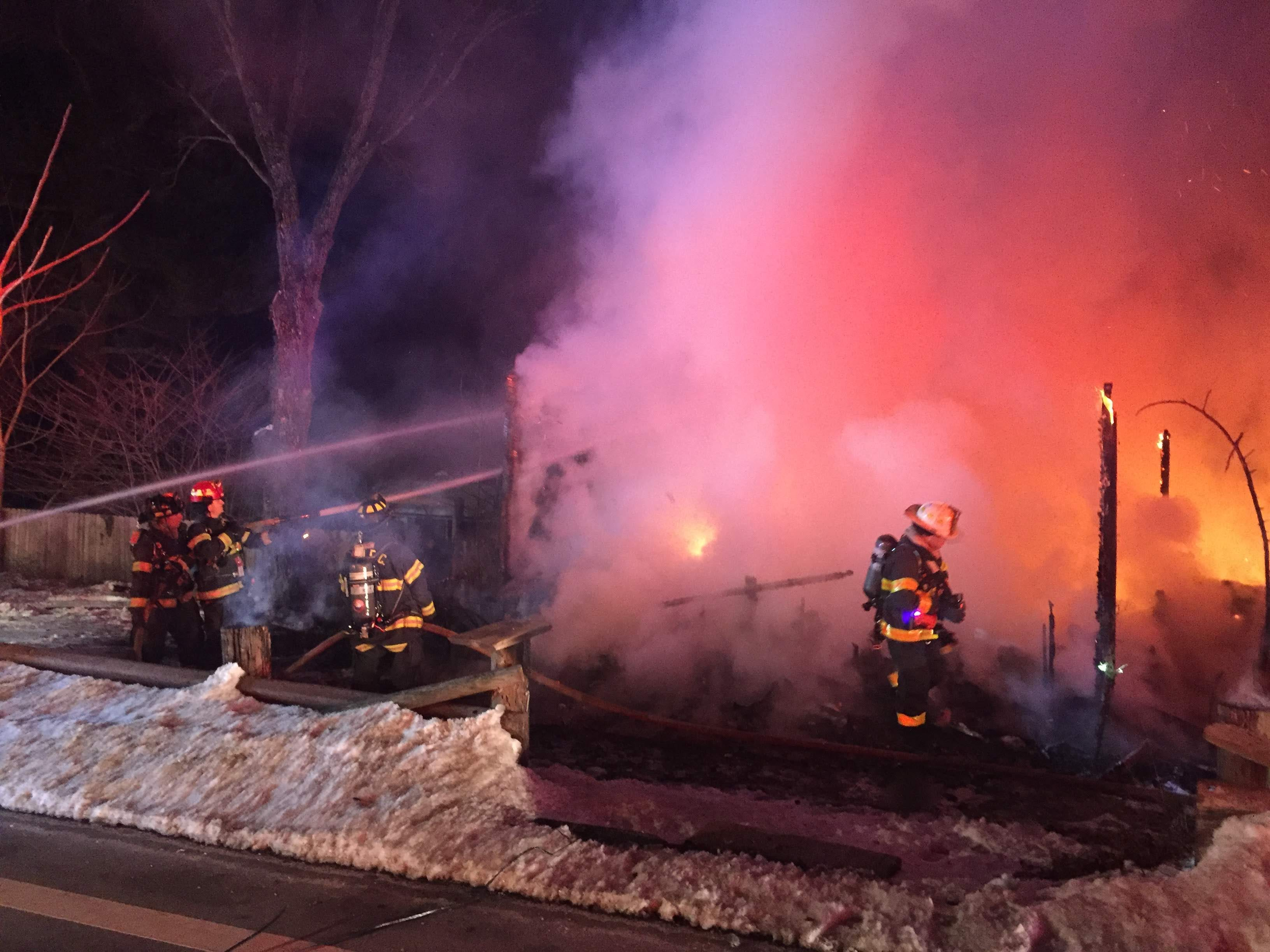 Fire fighters battle an early morning fire that claimed a two-story frame house on Route 24 in the Long Valley section of Washington. March 8, 2019