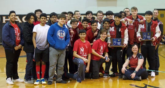 The Morris Hills boys and girls fencing teams both won District 1 titles.