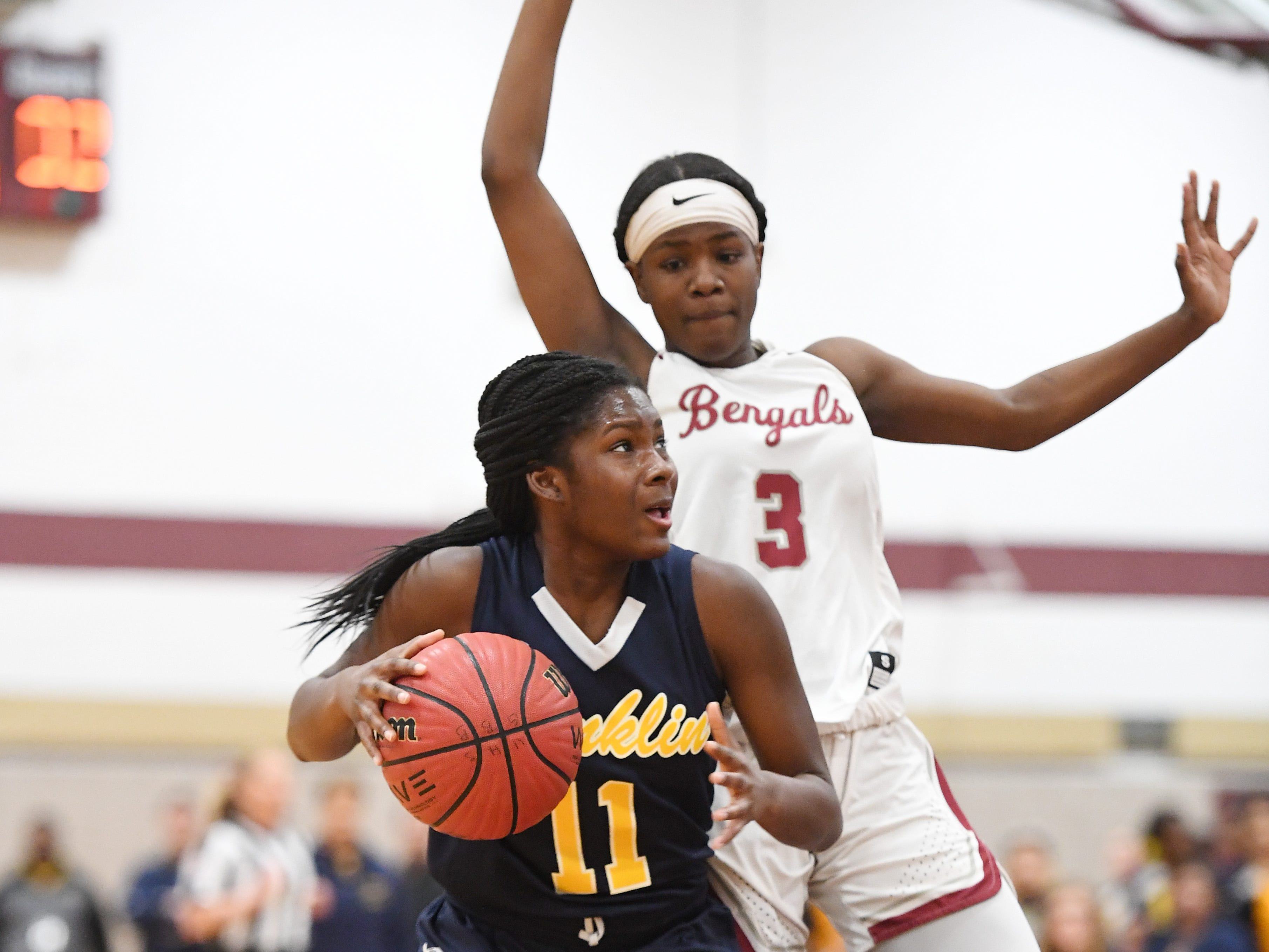 Franklin vs. Bloomfield in the girls basketball Group IV semifinal at Union High School on Thursday, March 7, 2019. F #11 Kennedy Schneck drives to the basket as B #3 Asiyah Edmond defends.