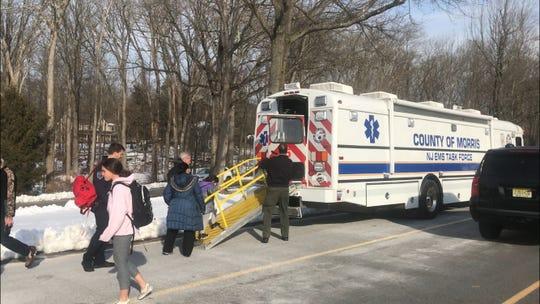 Students board the Morris County OEM mobile ambulance bus outside of Rockaway Valley School