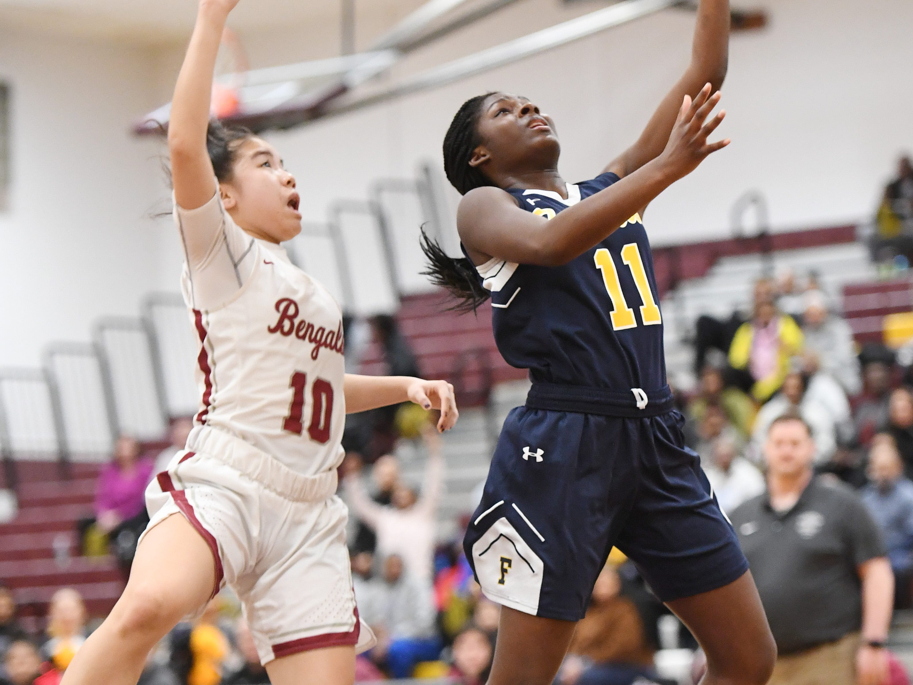 Franklin vs. Bloomfield in the girls basketball Group IV semifinal at Union High School on Thursday, March 7, 2019. F #11 Kennedy Schneck drives to the basket as B #10 Samantha Columna defends.