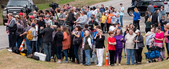 People gather to get a look at President Donald Trump during his visit to Beauregard, Ala., on Friday March 8, 2019. A fatal tornado struck Beauregard on Sunday March 3, 2019.