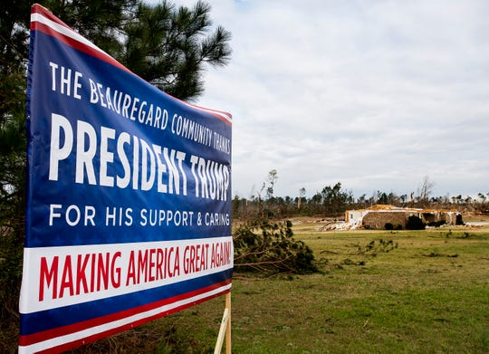 A sign welcomes President Donald Trump to Beauregard, Ala., on Friday March 8, 2019. A fatal tornado struck Beauregard on Sunday March 3, 2019.