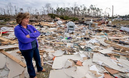 Cindy Sanford stands among the debris that was her home in Beauregard, Ala., on Friday March 8, 2019. A fatal tornado struck Beauregard on Sunday March 3, 2019.